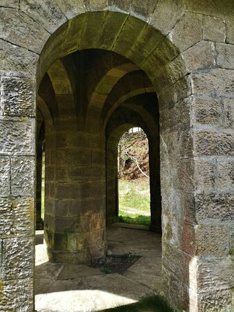 A view of the arches on a stone folly, shelter in the Cullaloe hills near Crossgates in Fife.