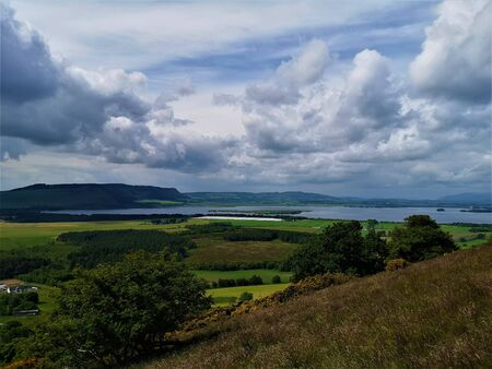 A view across Loch Leven toward Benarty hill from the slopes of the Bishop hill near Scotlandwell. Stock Photo