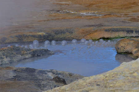 A view of the geothermal area at Hverir in Iceland which has boiling mud pools and Steaming fumaroles