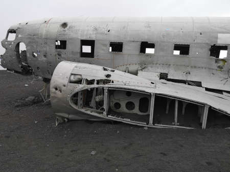 A view of an old crashed military aircraft on a black sand beach in southern Iceland Stock Photo