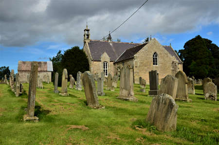 An exterior view of the old stone Church building in the Borders village of Edrom, Scotland 版權商用圖片