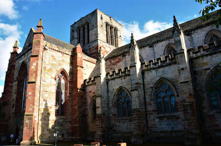 An exterior view of a medieval old stone Church building in the town of Haddington in Scotland