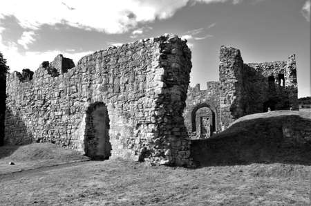 An exterior view of the ruins of the medieval Hailes Castle in Scotland