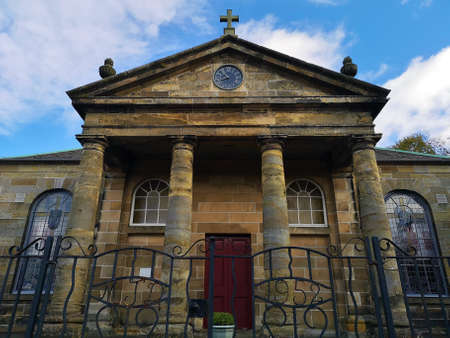 An exterior view of an old stone church building in the town of Penicuik in Scotland