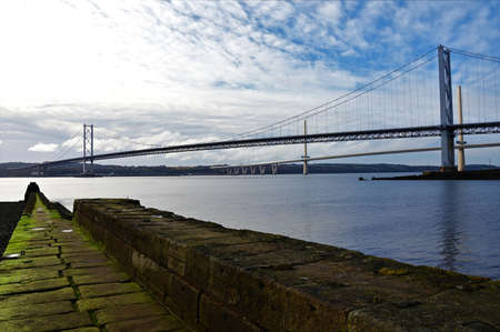 A view of the impressive, modern and historic Forth bridges from North Queensferry in Scotland.
