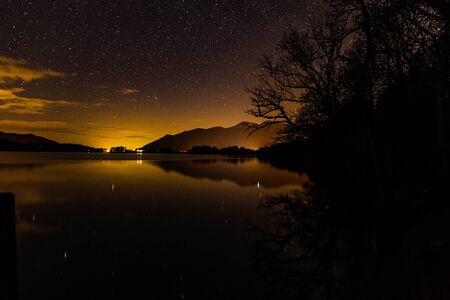 A starry night on ashness jetty with reflections