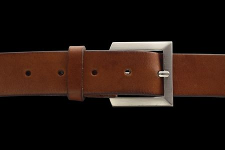 brown belt with buckle isolated on black background with clipping path