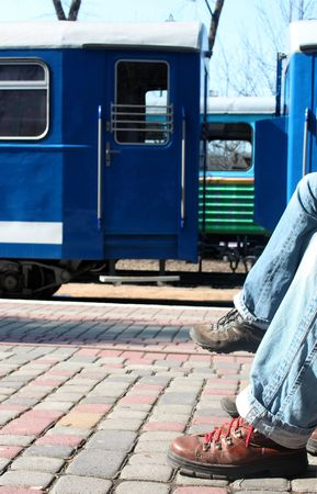 Two people waiting for train on railway station station