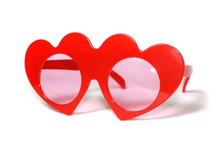 red heart-shaped glasses with pink glass on white background