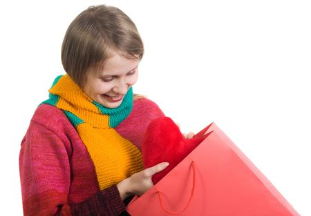 Cute woman happy to find fur hart in gift bag