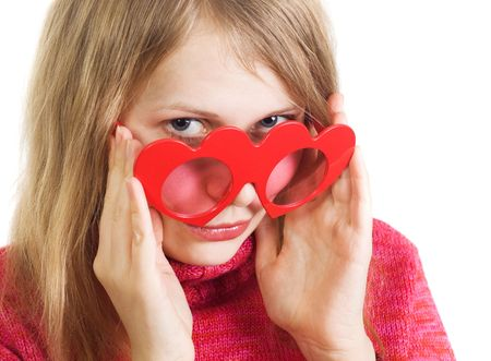Attractive charming blonde woman looking above red heart-shaped glasses, flirting, isolated on white background