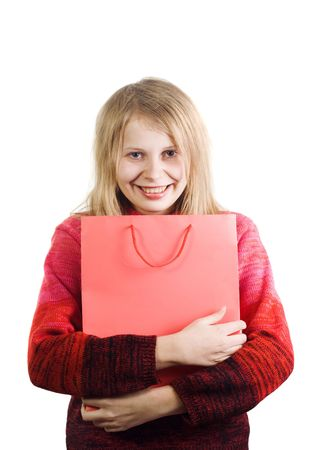 Pretty happy cheerful woman holding red shopping bag with empty space for text on it. Image all in red colors isolated on white