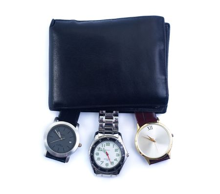 Concepts to use: time is money, time to grow rich, rule over time, time management. Wallet with three watches in it isolated on white