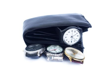 Concepts to use: time is money, time to grow rich, rule over time, time management. Wallet with four watches in it isolated on white Stock Photo