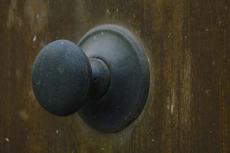 designates: Old door detail of the door handle Stock Photo