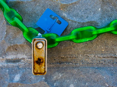 prison system: Chain with a padlock on a stone wall Stock Photo