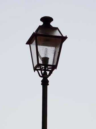 An ornate street lamp made of wrought iron.