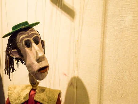 puppetry: Colorful surprised marionette looking on the right