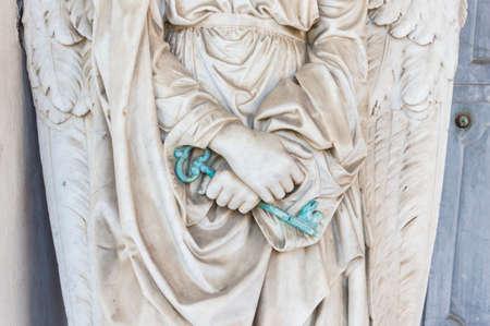 keys to heaven: Guardian angel holds the key to heaven door Stock Photo