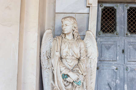 judgement day: Guardian angel holds the key to heaven door Stock Photo