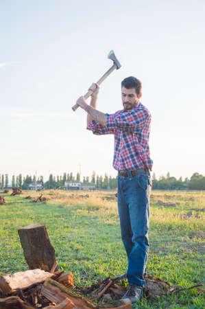 lumberman: His strong lumberman cuts wood with ax