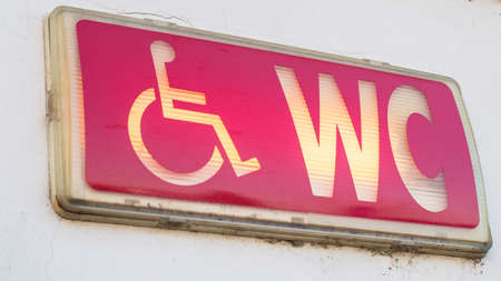 disable: Public restroom sign with a symbol disable access Stock Photo