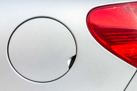 unleaded: A close up of a petrol cap cover on a modern white car Stock Photo