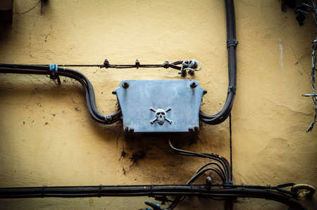 electroshock: High voltage danger sign on a old wall building Stock Photo