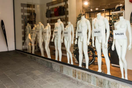 shop window: Window displays with text discounts in a shop SALES