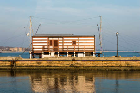 fishing hut: fishing hut with balance netfish Adriatic Sea in Italy Editorial