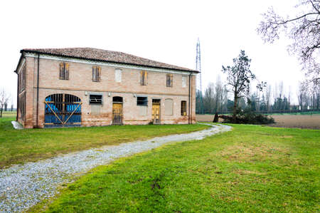abandoned farmhouse abandoned farmhouse: Abandoned old italian farmhouse with felled tree Editorial