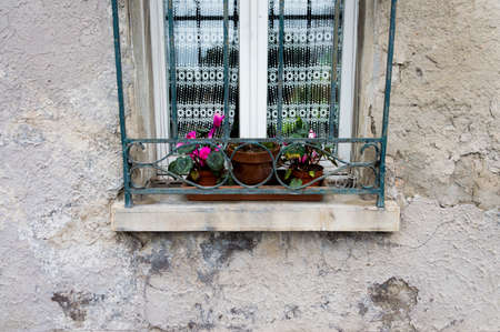 flower boxes: Detail of a windows with flower boxes in bad condition