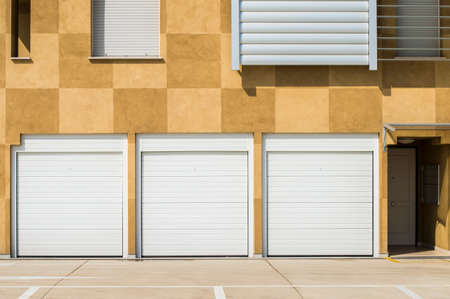 garage on house: Closed garage doors in a modern house Stock Photo