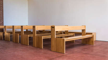 timber bench seat: A series of vintage wood banches in an essential context Stock Photo