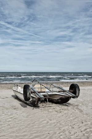 Old boat beached at the river of the sea