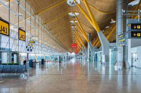 characterised: Madrid, Spain: 16th July 2016: The Madrid-Barajas Airport is Spains largest and busiest airport, characterised by a floating roof propped by an internal coloured structure.