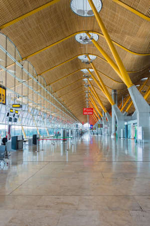 characterised: Madrid, Spain: 16th June 2016: The Madrid-Barajas Airport is Spains largest and busiest airport, characterised by a floating roof propped by an internal coloured structure. Editorial