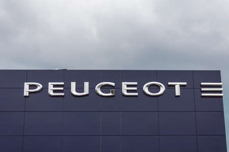 preceded: Forli, Italy - 26th March 2017: Logo of Peugeot. Peugeot is French car manufacturer. Family business that preceded current Peugeot company was founded in 1810 and manufactured coffee mills and bicycles.