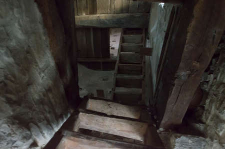 Stairs and underground cellars in old medieval tower