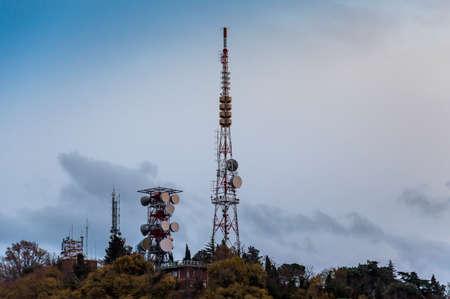 Telecommunication Radio Antenna and Satelite Tower with blue sky