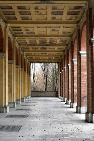 Lost building: long abandoned open gallery with bare trees