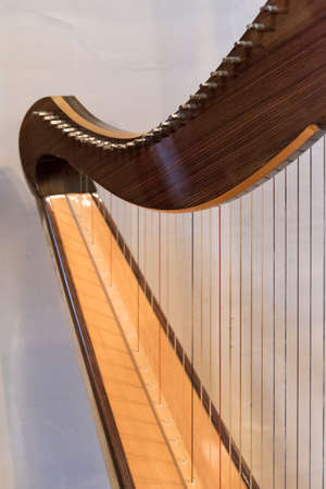 Celtic irish harp, classical and traditional string music instrument, detail.