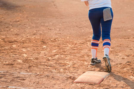 Player stand on home plate in a baseball (softball) dusty field, with copyspace Stock Photo