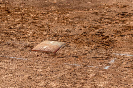 Detail of a home plate in a baseball (softball) dusty field, with copyspace Stock Photo