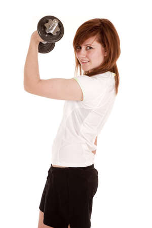 a woman lifting weights to make her bicepts look bigger. photo