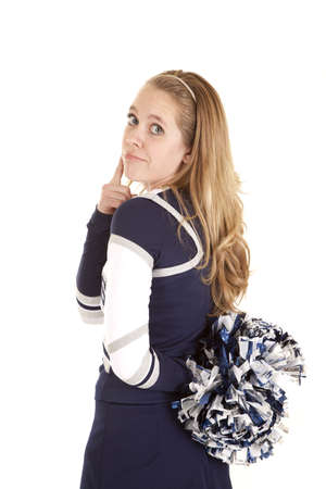 A cheerleader holding her pom pom by her back thinking. photo