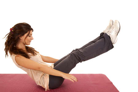 A woman exercising and doing a crunch to work her abs. photo