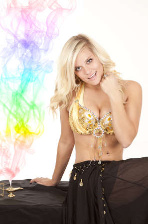 a female genie sitting next to her magic lamp with colorful smoke coming out of it. Stock Photo - 12104781