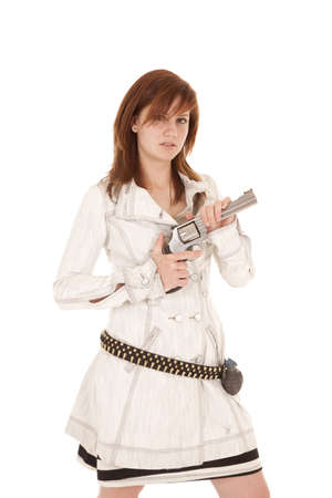 A woman holding a gun with  a grenade on her belt.