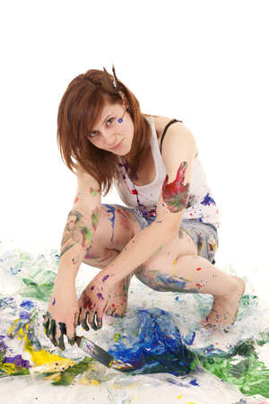 a woman covered in paint with  a small smile on her lips. Archivio Fotografico